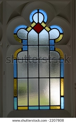 Simple Stained Glass Window In A Wooden Door Possibly Church Or Old Building
