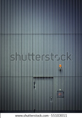 Simple steel wall with door and alarm lamp - stock photo