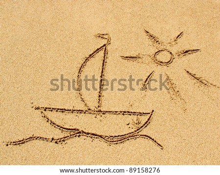 simple sun drawing in the sand on the beach - stock photo