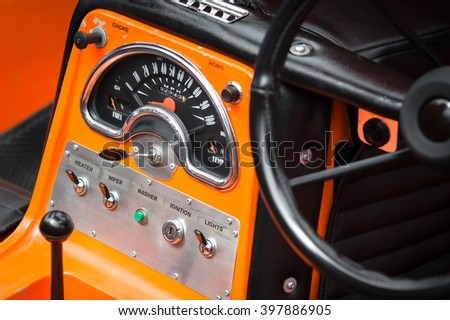 simple switch and dial dashboard on a retro vehicle - stock photo