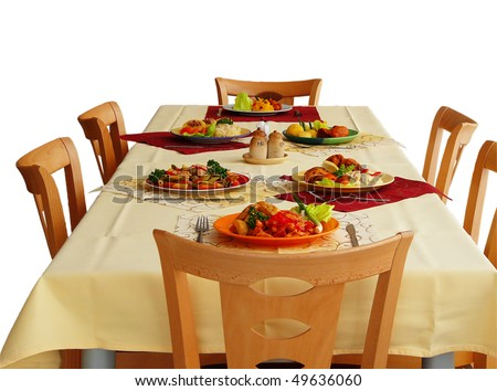 simple table settings with different types of meals - stock photo