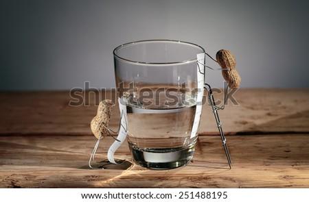 Simple Things Peanuts Miniature - Half Empty or Half Full - stock photo