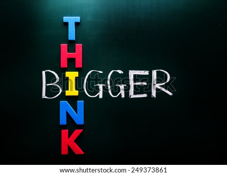 Simple Think Bigger Concept, with Colorful THINK Letters Crossing on BIGGER Text at Green Chalkboard - stock photo