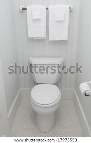 Simple white bathroom toilet lid down - stock photo