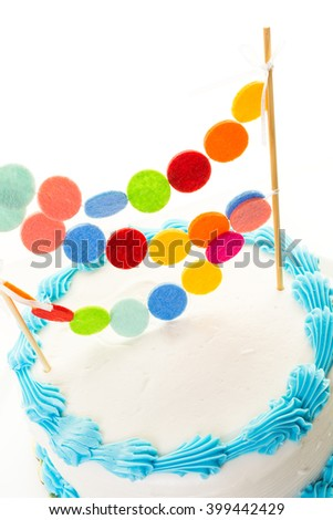 Simple white Birthday cake with cake garland.