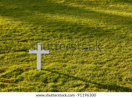 Simple white cross in lawn at Robert Kennedy memorial in Arlington Cemetery - stock photo