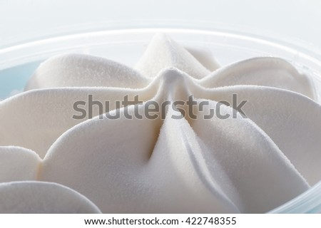 simple white ice cream in  plastic box macro shot  - stock photo