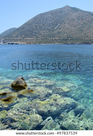 Simple wooden boat on clear turquoise water