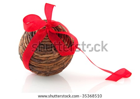 Simple wooden Christmas ball with red ribbon