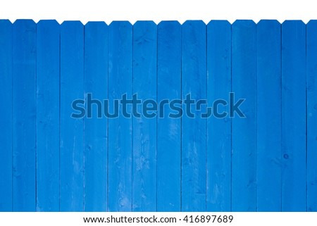 Simple wooden slat fence with parallel planks stained with royal blue paint over a white beackground - stock photo