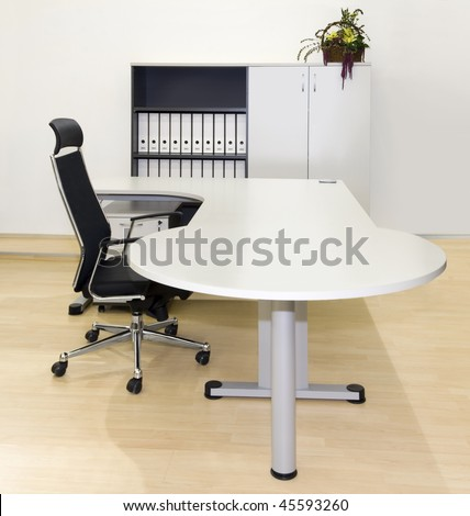 Simple workplace in modern office - stock photo