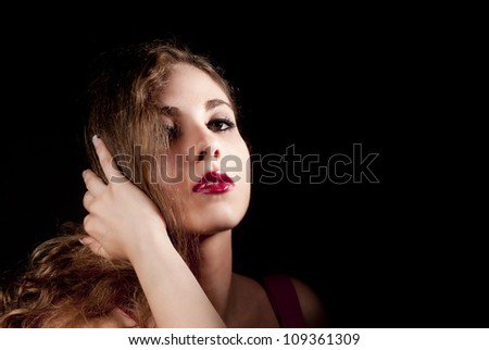 Simply a portrait of a nice woman lokking you on black background - stock photo