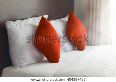 simply modern bedroom decorated with orange pillow. - stock photo