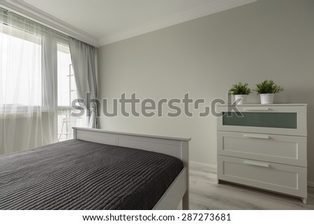 Simply modern bedroom furniture in white interior - stock photo