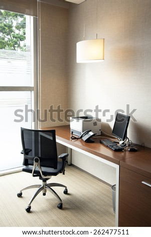 Simply office table with desktop and printer