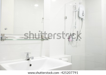 simply white bathroom in hotel. - stock photo