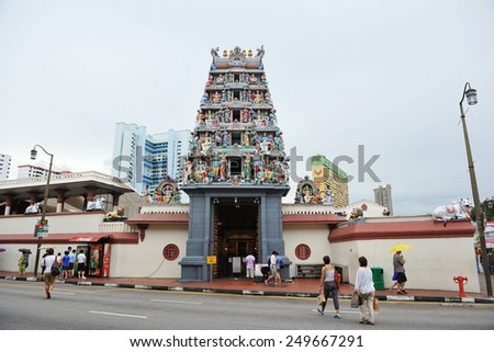 SINAGPORE - MAY 10: View of the Sri Mariamman temple in the multi-faith and culturally diverse city state on May 10, 2013 in Singapore. The temple is one of the most sacred Hindhu sites in Singapore.  - stock photo