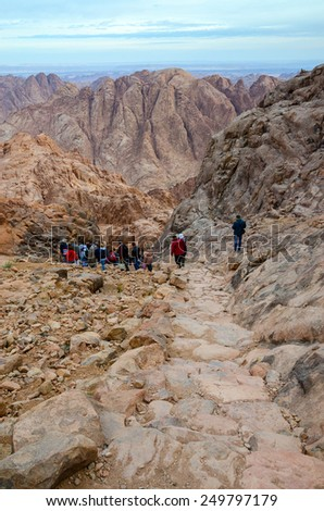 SINAI, EGYPT - NOVEMBER 28, 2013: Tourists descend on the long trail from the top of Mount Moses, Egypt - stock photo