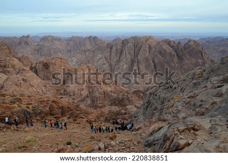 SINAI,  MOSES MOUNTAIN, EGYPT - NOVEMBER 28, 2013: unknown tourists descend from the top of Moses Mountain in November 28, 2013 in Sinai, Egypt   - stock photo