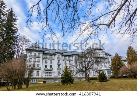 Sinaia, Romania - March 14: Sinaia on March 14, 2016 in Sinaia, Romania. Horizontal image with vegetation and famous architectural building in the park.