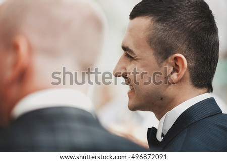 Sincere smile of the groom on the wedding