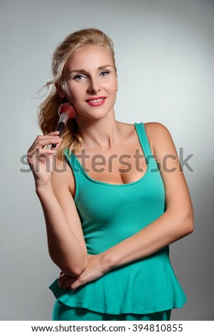 Sincere spread smile and beautiful face. Stunning blonde with long gentle hands. - stock photo