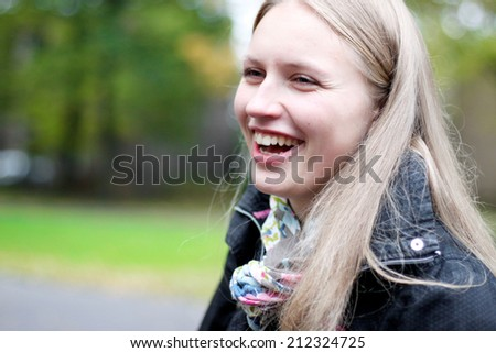 Sincerely laughing young beautiful woman - stock photo