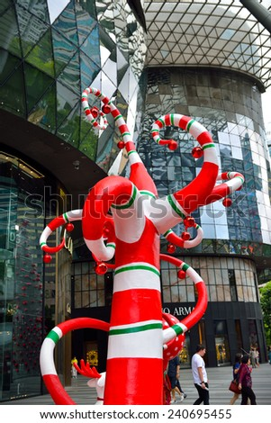 SINGAPOR -DEC 29: Night view of Christmas Decoration at Singapore Orchard Road on December 29, 2014 in Singapore. The street with colourful christmas trees, ball, stars & dressed-up shopping centres. - stock photo