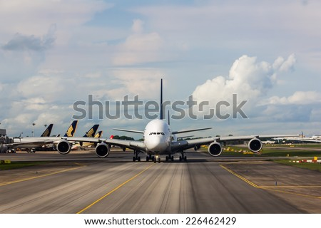 Singapore Airport - AUG 7: Singapore airline prepared to takeoff from Singapore Airport in Singapore on August 7, 2014.  - stock photo