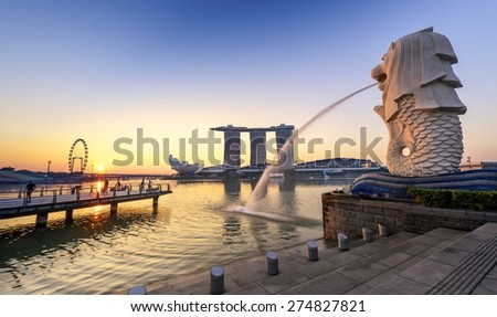 SINGAPORE-APR 21 : The Merlion and the Marina Bay Sands Resort Hotel, billed as the world's most expensive standalone casino property at S$8 billion on APR 21, 2015 in Singapore. - stock photo