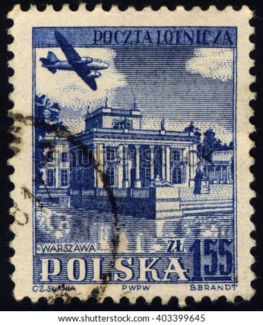 SINGAPORE - APRIL 10, 2016: A stamp printed in Poland shows Lazienki Palace â?? Warsaw, Airplane over historic, circa 1954.