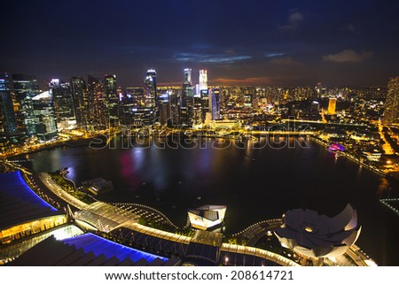 SINGAPORE - APRIL 15, 2012: A view of city from roof Marina Bay Hotel on Singapore. This hotel is billed as the world's most expensive standalone casino property at S$8 billion. - stock photo