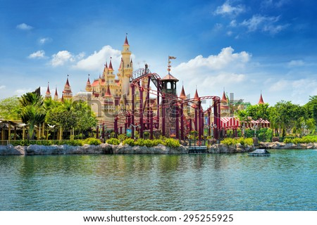 SINGAPORE - APRIL 18:  Beautiful castle and roller coaster in Universal Studios on April 18, 2015. Universal Studios Singapore is theme park located within Resorts World Sentosa, Singapore. - stock photo