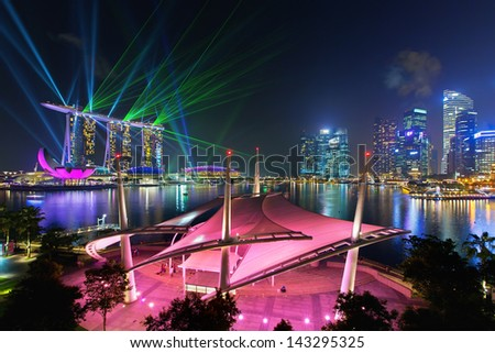 SINGAPORE -APRIL 4: Beautiful laser show at the Marina Bay waterfront in Singapore. Wonder Full laser show and water spectacular in Southeast Asia on Apr 4, 2013, Singapore - stock photo