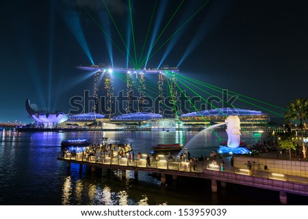 SINGAPORE -APRIL 4: Beautiful laser show at the Marina Bay waterfront in Singapore. Wonder Full laser show and water spectacular in Southeast Asia on April 4, 2013, Singapore - stock photo