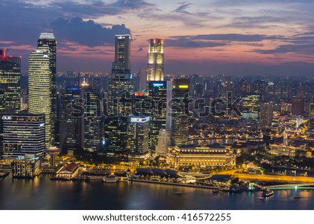 SINGAPORE - April 14, 2016: Cityscape on top from Marina Bay Sands Sky park at twilight time.