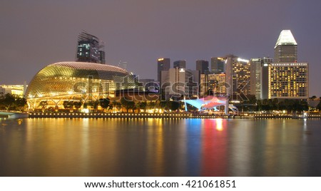 SINGAPORE - APRIL 10, 2016: Esplanade - Theatres on the Bay is a performance and art center located in Marina Bay. It is nicknamed the Durian by the Singaporeans because of its spikey appearance. - stock photo