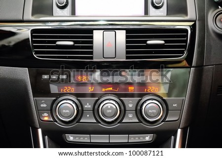 SINGAPORE - APRIL 13: Front multimedia screen, air-conditioner control and gear lever of new Mazda CX-5 crossover SUV at its launch event April 13, 2012 in Singapore - stock photo