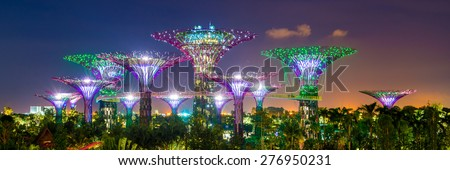 SINGAPORE - APRIL 06: Futuristic view of amazing illumination at Garden by the Bay on April 6, 2013 in Singapore. Night light show at Supertree is main Marina Bay Sands district tourist attraction - stock photo