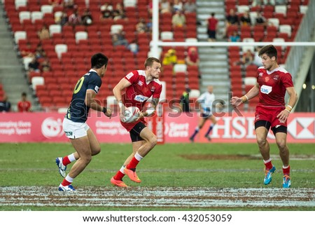 SINGAPORE-APRIL 17: Japan 7s Team (blue) plays against Russia 7s team (red) during Day 2 of HSBC World Rugby Singapore Sevens on April 17, 2016 at National Stadium in Singapore