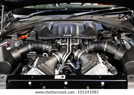 SINGAPORE - APRIL 28: 4.4L V8 twin turbo engine of BMW M6 Convertible at its Preview at Singapore Yacht Show April 28, 2012 in Singapore - stock photo