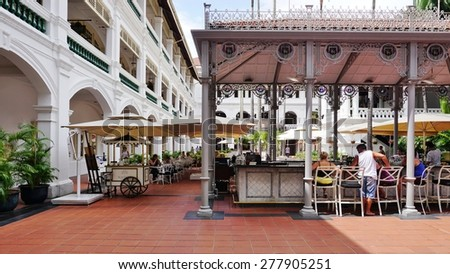 SINGAPORE -17 APRIL 2015- Opened in 1887 and located in the Civic District, the colonial style Raffles Hotel is the most famous luxury hotel in Singapore and a historic landmark.  - stock photo