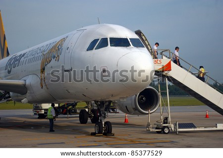 SINGAPORE - APRIL 30: Pilots disembarking an air plane on April 30, 2009 in Singapore. Profits for Asian airlines are likely to keep falling, after a 69% drop so far in 2011 and a 56% drop worldwide. - stock photo