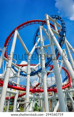 SINGAPORE - APRIL 18: Roller coaster in Universal Studios Singapore at Singapore Resorts World Sentosa on April 18, 2015.  - stock photo