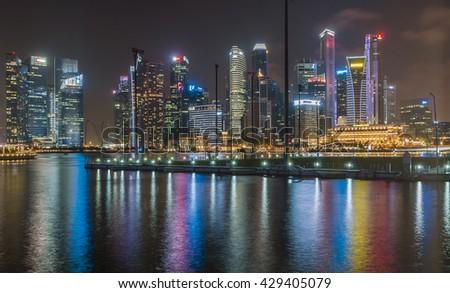 Singapore 02 April 2016: Singapore cityscape at Marina Bay view night. - stock photo