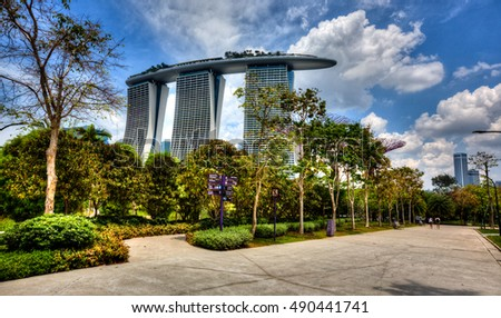 SINGAPORE, 4 April 2016 - Singapore's famous Marina Bay Sands hotel towers over Gardens by the Bay