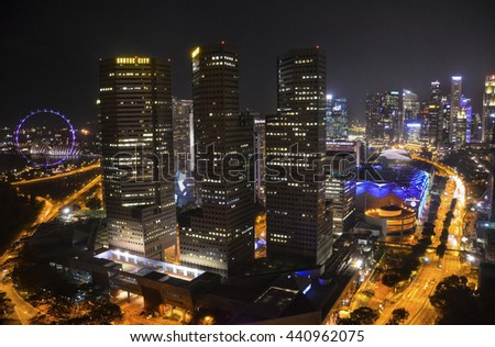 SINGAPORE - APRIL 09: Singapore skyline at night, business center of Singapore at evening, aerial view from the top 09 of April, 2014