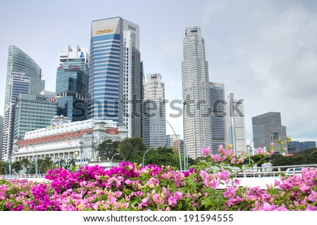 SINGAPORE-APRIL 14: Skyscraper and flowers at the Marina bay of Singapore. April 14, 2014