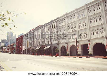SINGAPORE - APRIL 16: Street scene in Singapore's Chinatown on April 16, 2012 in Singapore. The city state's ethnic Chinese began settling in Chinatown circa 1820s.  - stock photo