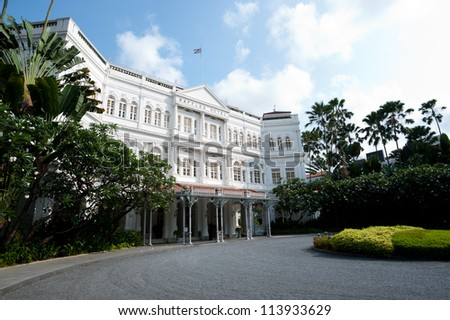 SINGAPORE - APRIL 23: The Raffles Hotel opened in 1899, and is named after Singapore's founder Sir Stamford Raffles. April 23, 2011 in Singapore, Singapore - stock photo